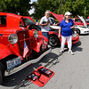 "From the left: Joe and Diane Reid Adams check out the classic cars and trucks with their puppy, ""Samuel Adams' on Saturday during the car show at Park Days in Ewert Park.<br /> Globe 