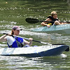 From the left: Sarah Herbert, of Bella Vista, Ark. and 12-year-old Sam Rider, of Bronaugh, paddle their way down Shoal Creek in the cardboard canoe race during the Shoal Creek Water Festival on Saturday at Wildcat Glades.<br /> Globe | Laurie Sisk