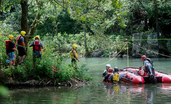 Members of the Joplin Fire Department practice swift water rescue training at Shoal Creek on Wednesday afternoon.<br /> Globe   Roger Nomer
