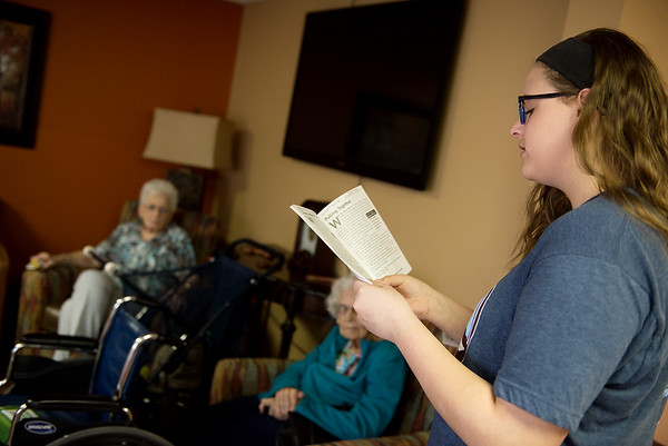 Riley Chaffee, a College Heights sophomore, reads a devotion to residents at Spring River Christian Village on Monday.<br /> Globe | Roger Nomer