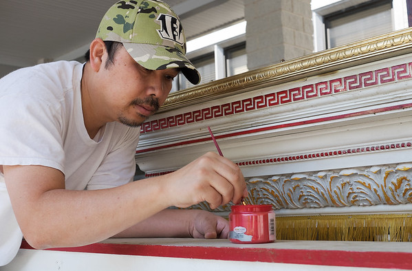 Hoa Dao, Orange County, Calif., paints in preparation for Marian Days at the Congregation of the Mother of the Redeemer on Wednesday.<br /> Globe | Roger Nomer