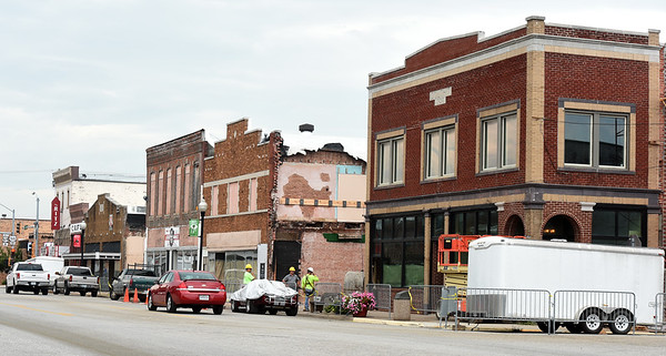 Work continues Friday on the decades of Wheels project in downtown Baxter Springs. The development will include a car museum, two restaurants and an arcade. A grand opening is planned in mid-October.<br /> Globe | Laurie Sisk