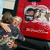 Stephanie Kalng, retired CFI driver, gets a hug from Casey Antle, dispatcher planner, during the reveal of a CFI truck honoring female drivers on Tuesday. Kalng is portrayed on the side of the truck.<br /> Globe | Roger Nomer