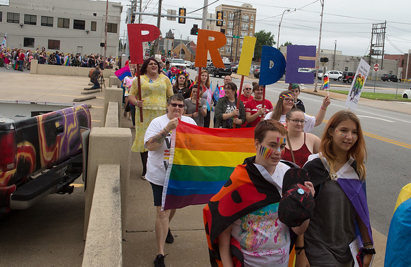 Participants in Saturday's 2019 Downtown Diversity Pridefest march along 4th Street, commemorating the 50th anniversary of the Stonewall Riots.<br /> Globe | Roger Nomer