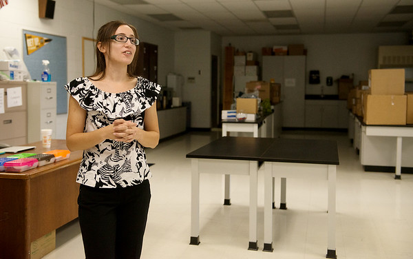 Alicia Abruzzo, science teacher at McAuley High School, gives a tour of her classroom following a ribbon cutting on Aug. 8.<br /> Globe | Roger Nomer