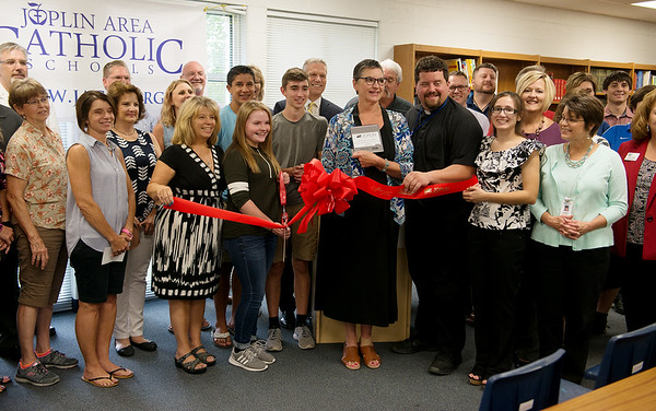 The ribbon is cut for Project Lead the Way at McAuley High School on Aug. 8. <br /> Globe | Roger Nomer