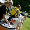 Amie Henson, a Missouri Southern sophomore from Jefferson City, stocks cold water for the Missouri Southern first day of school picnic on Monday.<br /> Globe | Roger Nomer