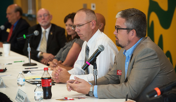 Missouri House candidates David Osborn, left, and Raleigh Ritter talk during Thursday's forum at Missouri Southern.<br /> Globe | Roger Nomer