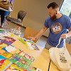 Ben Davis, counselor at West Central, collects books donated by The Alliance of Southwest Missouri on Monday at Joplin High School.<br /> Globe | Roger Nomer