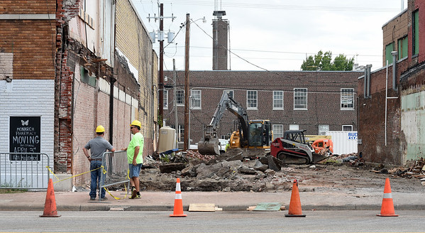 Work continues Friday on  the Decades of Wheels project in downtown Baxter Springs. The development also will include two restaurants,a bed and breakfast, a spacious car museum and an arcade. A grand opening is planned in mid-October.<br /> Globe | Laurie Sisk