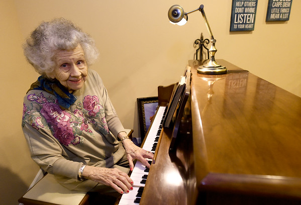 "Alzheimer's patient Florlene Young plays and sings ""Funny How Time Slips Away"" on Tuesday at College View Manor. Young has not lost her ability to share her love of music and remains an accomplished pianist, though she admits her vocal abilities have slipped slightly.<br /> Globe 