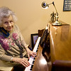 """Alzheimer's patient Florlene Young plays and sings """"Funny How Time Slips Away"""" on Tuesday at College View Manor. Young has not lost her ability to share her love of music and remains an accomplished pianist, though she admits her vocal abilities have slipped slightly.<br /> Globe 