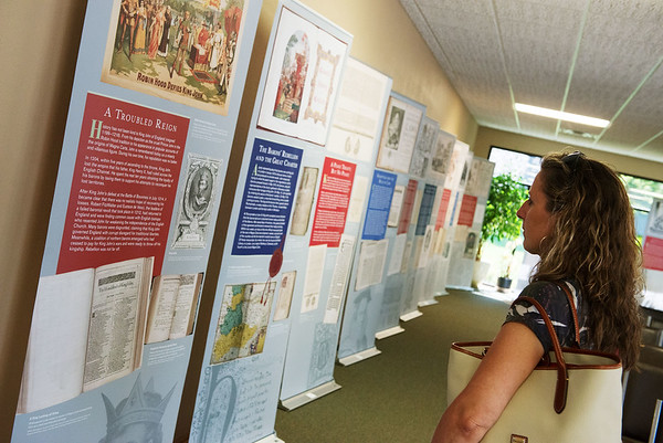 Joy Crockett, Baxter Springs, checks out an exhibit on the Magna Carta at the Baxter Springs Heritage Museum on Friday. The exhibit runs through Aug. 17, and then moves on to Parsons.<br /> Globe | Roger Nomer
