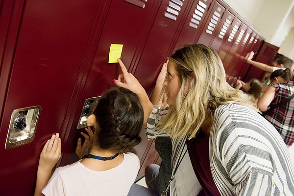 Katie Juergens helps a sixth grader with her locker combination on Thursday at North Middle School.<br /> Globe   Roger Nomer