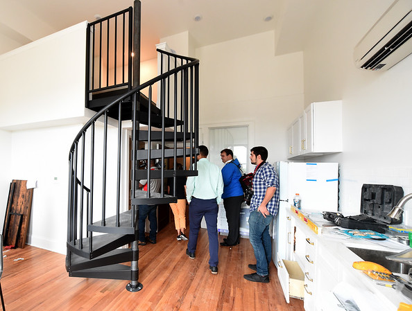Pittsburg city officials and members of the media tour a student apartment inside the National Bank Building - part of the Block22 project - on Tuesday in downtown Pittsburg.<br /> Globe   Laurie Sisk