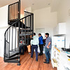 Pittsburg city officials and members of the media tour a student apartment inside the National Bank Building - part of the Block22 project - on Tuesday in downtown Pittsburg.<br /> Globe | Laurie Sisk
