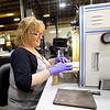 Production Tech Denise Wammack covers electrods with electrolyte wick on Thursday at ZAF Energy Systems. The company is one of several in the area who plan to expand their workforces.<br /> Globe | Laurie SIsk