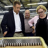 From the left: CNC Machine Products, Inc. Vice President of Manufacturing Jeff Scheurich and CNC Vice President of Sales Rick Braddish discuss the challenges their company faces because of trade tariffs on steel as they stand near a box of rollers during a visit with U.S. Sen. Claire McCaskill on Wednesday at CNC.<br /> Globe | Laurie Sisk