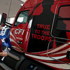 Josh Armstrong, CFI driver and US Marine veteran, looks over his new True to the Troops truck on Tuesday at CFI.<br /> Globe | Roger Nomer
