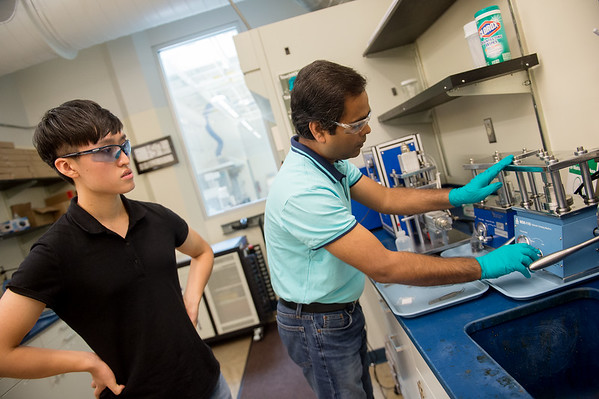 Jonghyun Choy, international student at Pittsburg State University and Ram Gupta, associate professor in the chemistry department at Pittsburg State University, assemble a battery that uses coffee grounds on Monday at PSU.<br /> Globe | Roger Nomer