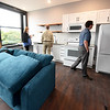 Pittsburg city officials tour a student apartment inside the Commerce Building - part of the Block22 project - on Tuesday in downtown Pittsburg.<br /> Globe   Laurie Sisk