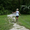 Kelly Johnson takes Riley for a run at the outdoor track at the Joplin Humane Society on Monday.<br /> Globe | Roger Nomer