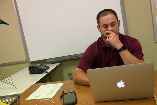 Michael Juergens works on his computer at North Middle School on Thursday.<br /> Globe | Roger Nomer