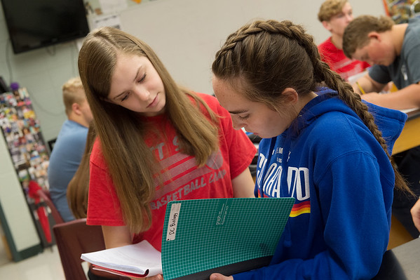 Rachel Case, left, and Jamie Fabozzi, both sophomores at Carl Junction High School, talk about a lab write up on Thursday.<br /> Globe   Roger Nomer