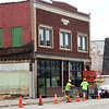 Work continues Friday on one of two cafes that are part of the Decades of Wheels project in downtown Baxter Springs. The development also will include a spcious car museum and an arcade. A grand opening is planned in mid-October.<br /> Globe | Laurie Sisk