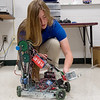 Ashley Stokes, a senior at Carl Junction High School, works on a TSA competition robot on Friday.<br /> Globe | Roger Nomer
