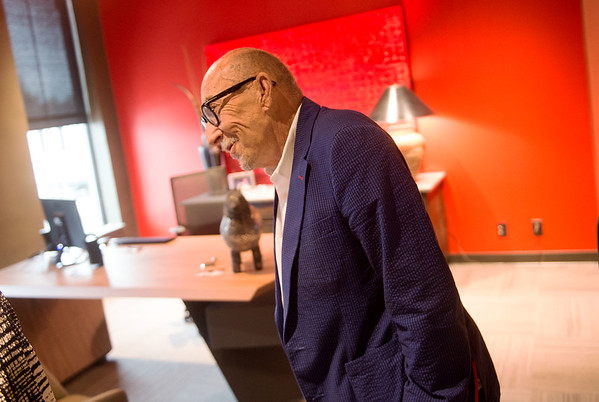 William H. Perry III, co-owner of Cardinal Detecto, welcomes visitors to his new office on Friday.<br /> Globe | Roger Nomer