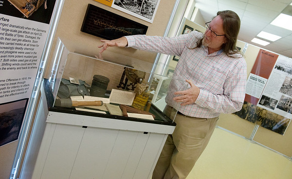 Christopher Wiseman, director of the Joplin History Museum, talks about items on display in a World War I exhibit at the museum on Thursday.<br /> Globe | Roger Nomer