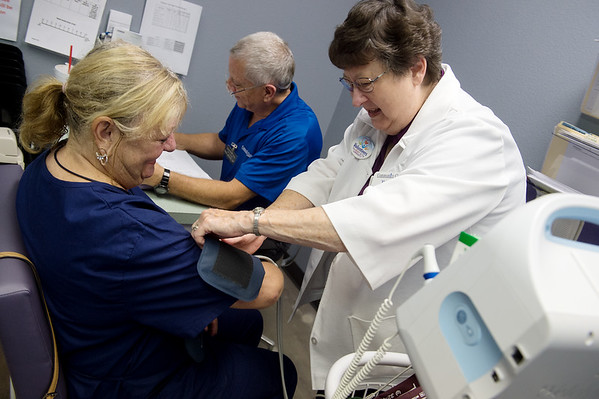Steve Weston and Yvonne Kelly check in Sandy Conlee to the Joplin Community Clinic on Thursday.<br /> Globe   Roger Nomer