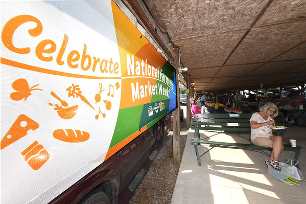 A large banner recognizes National Farmers Market Week on Saturday at the Webb City Farmers Market.<br /> Globe | Laurie Sisk