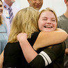 Abbey Cahalan, McAuley High freshman, gets a hug from McAuley Principal Tracey Welch following a ribbon cutting on Aug. 8 at the school. Cahalan is one of the students taking part in Project Lead the Way.<br /> Globe | Roger Nomer