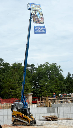 A banner hanging from a crane illustrates the 45-foot drop for the new Mystic River Falls at Silver Dollar City.<br /> Globe | Laurie Sisk