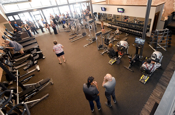 Visitors check out the equipment inside the new Carthage YMCA on the square before ribbon cutting ceremonies on Wednesday at the YMCA.<br /> Globe | Laurie Sisk