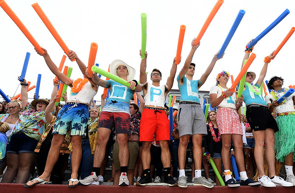 """From the left: Joplin High School students Kaden Parker, Kirk Chandler, Jake Taylor, Tommy Hafer, Will Rader and Colton Landis spell out """"J-O-P-L-I-N"""" as they cheer on the Eagles during the JHS season opener against Willard on Friday night at Junge Stadium.<br /> Globe 