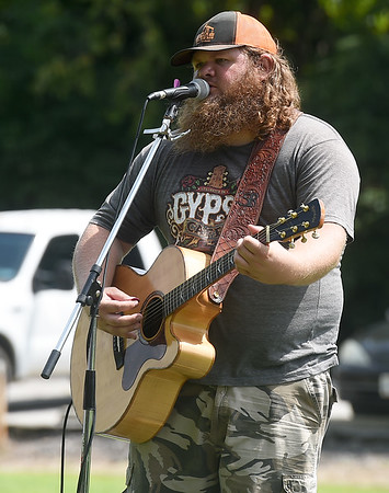 Seth Riley entertains the crowd on Saturday during the Shoal Creel Water Festival at Wildcat Glades.<br /> Globe | Laurie Sisk
