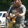 Seth Riley entertains the crowd on Saturday during the Shoal Creel Water Festival at Wildcat Glades.<br /> Globe   Laurie Sisk