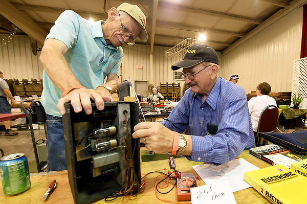 From the left: Brothers Ed Grimes, of Republic and Mike Grimes, of Owasso, Okla., work on a World War II era short wave receiver during Hamfest on Friday at the Jack Lawton Webb Convention Center. The two-day event, hosted by the Joplin Amateur Radio Club, featured more than 50 vendors and celebrated the club's 30th year hosting the event.<br /> Globe | Laurie Sisk