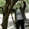 """Pittsburg State student Ximena Bogarin clears small obstructive limbs from a tree in preparation for the placement of  """"camera traps"""" on Thursday in a wooded area near Pittsburg.<br /> Globe   Laurie Sisk"""