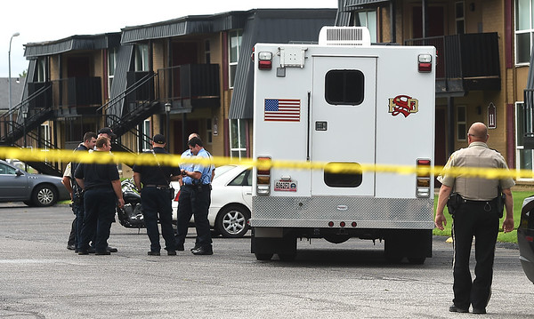 Members of local law enforcement collaborate with members of the Springfield Fire Department Bomb Squad after the report of a suspicious device on Thursday at the Royal Orleans Apartment Homes near Missouri Southern.<br /> Globe | Laurie Sisk