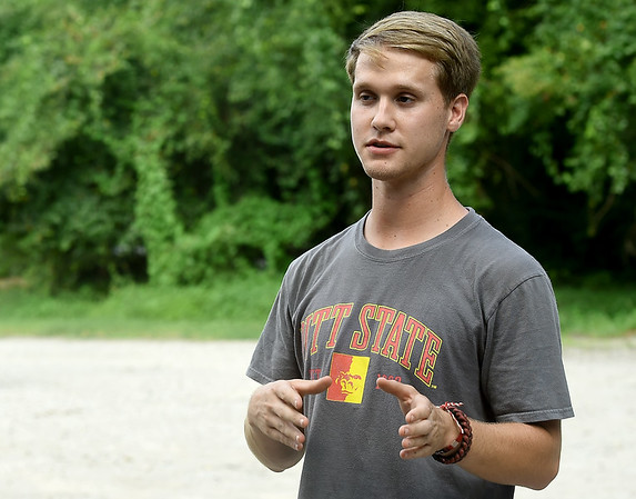 """Pittsburg State student Caleb Durbin talks about the use of """"camera traps"""" to identify different species of southeast Kansas mammals on Thursday near Pittsburg. The project is part of a 50-state Smithsonian snapshot program intended to identify which specific mammals live in what areas. <br /> Globe   Laurie Sisk"""