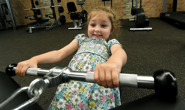 Three-year-old Maddie Petersen, of Carthage, checks out some of the equipment at Carthage's new downtown YMCA on the square in Carthage on Wednesday. <br /> Globe  Laurie Sisk