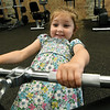 Three-year-old Maddie Petersen, of Carthage, checks out some of the equipment at Carthage's new downtown YMCA on the square in Carthage on Wednesday. <br /> Globe| Laurie Sisk