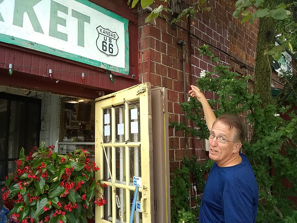 Owner Scott Nelson points to the exterior brick of the Old Riverton Store in Kansas on Friday, which will be updated in a $5,000 tuck pointing project later this year. Nelson was one of the last recipients along the Mother Road to receive a cost-share grant through the Route 66 Corridor Preservation Program, which is due to sunset this fall.  Kimberly Barker/JoplinGlobe