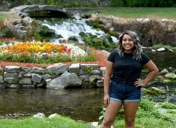 """Arely Avitua stands in front of the water feature at Big Spring Park in Neosho on Wednesday. Avitua recently was the youngest cast member of the MTV-produced reality show, """"The Real World.""""<br /> Globe 