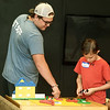 Boys and Girls Club of Southwest Missouri staff member Matt Miller and Logan Noland, 11, get their creative juices flowing with Legos during the club's ummer program on Wednesday at the club. The program concludes Friday at the club.<br /> Globe | Laurie Sisk