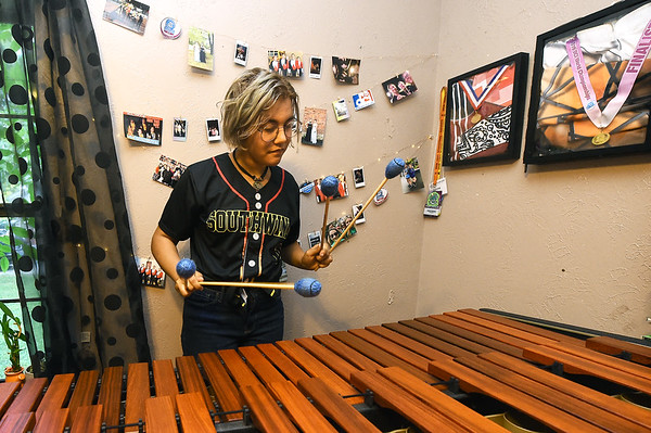 Webb City Hgh School senior Anna Struble practices her marimba on Thursday at her Oronogo home. Struble just completed her second year touring with the Southwind Drum and Bugle Corps of Mobile, Ala.<br /> Globe | Laurie Sisk